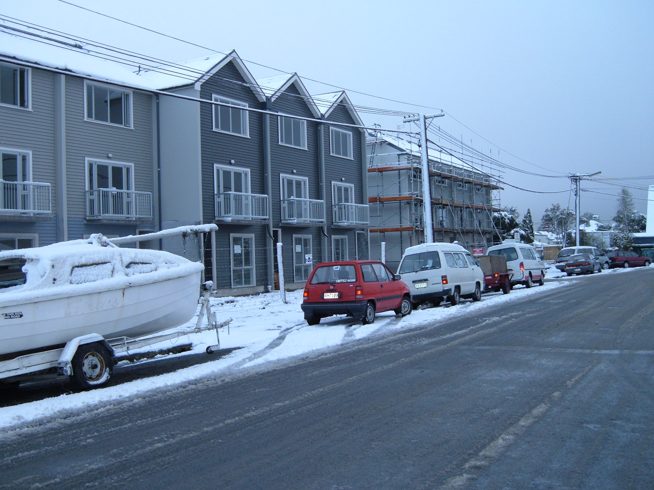 Our team working on the Poulson St 3 Story Units in the snow in Christchurch